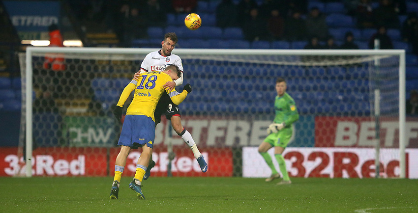 Bolton Wanderers' Christian Doidge and Leeds United's Pontus Jansson<br /> <br /> Photographer Stephen White/CameraSport<br /> <br /> The EFL Sky Bet Championship - Bolton Wanderers v Leeds United - Saturday 15th December 2018 - University of Bolton Stadium - Bolton<br /> <br /> World Copyright © 2018 CameraSport. All rights reserved. 43 Linden Ave. Countesthorpe. Leicester. England. LE8 5PG - Tel: +44 (0) 116 277 4147 - admin@camerasport.com - www.camerasport.com