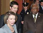 Washington, DC - March 5, 2009 -- Brad Pitt speaks to press after meeting with Democratic leadership in the U.S. Capitol in Washington, D.C. on Thursday, March 5, 2009.   From left to right: Speaker of the United States House of Representatives Nancy Pelosi (Democrat of California); Brad Pitt; and House Democratic Whip James E. Clyburn (Democrat of South Carolina)..Credit: Ron Sachs / CNP