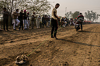 FARIDKOT, PUNJAB, INDIA - JANUARY 05, 2016: Men re-set a dead-rabbit pulley system, used to bait  greyhounds down the track during a greyhound race meet on January 5, 2016 in Faridkot, India. <br /> Daniel Berehulak for The New York Times