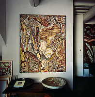 The interior of artist Gerard Drouillet's townhouse in the centre of Eygalieres. The house is typical of the south of France and the rooms are filled with his artwork.