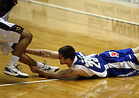 Saints import Eric Devendorf brings down Corey Webster during the National Basketball League match between the Wellington Saints and Harbour Heat at TSB Bank Arena, Wellington, New Zealand on Thursday, 29 April 2010. Photo: Dave Lintott / lintottphoto.co.nz