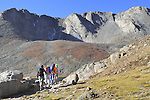 Four women hiking towards the summit of  Mount Evans (14250 feet) in the Rocky Mountains west of Denver, Colorado. Private photo tours to Mt Evans.