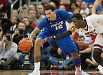 Center Willie Cauley-Stein of the Kentucky Wildcats steals the ball during the game against  the Louisville Cardinals at KFC Yum! Center on Saturday, December 27, 2014 in Louisville `, Ky. Kentucky defeated Louisville 58-50. Photo by Michael Reaves | Staff
