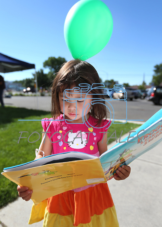Miya Kuniya, 3, gets a new book at the Summer Reading Program Pancake Breakfast Kick-Off at the Carson City Library, in Carson City, Nev., on Saturday, June 8, 2013. <br /> Photo by Cathleen Allison