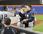 (R-L) Masahiro Tanaka, Mark Teixeira, Alfonso Soriano (Yankees),<br /> MAY 14, 2014 - MLB :<br /> Masahiro Tanaka of the New York Yankees is congratulated by his teammates Mark Teixeira and Alfonso Soriano back in the dugout after his first MLB hit in the ninth inning during the Major League Baseball game against the New York Mets at Citi Field in Flushing, New York, United States. (Photo by AFLO)
