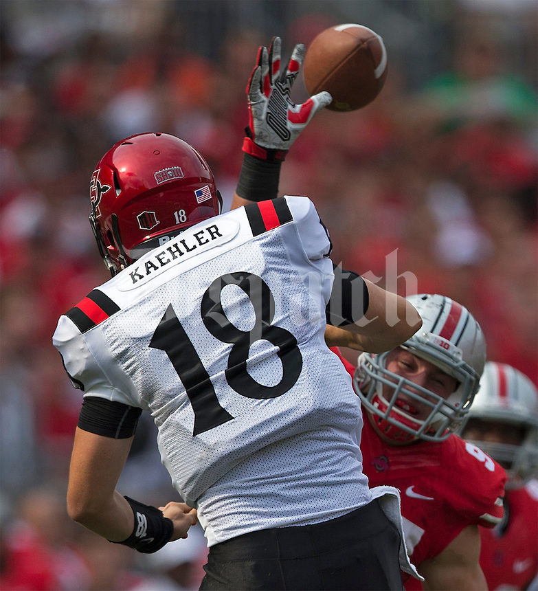 Ohio State Buckeyes defensive lineman Chris Rock (91) just misses knocking down San Diego State Aztecs quarterback Quinn Kaehler's (18) pass during the second quarter of the NCAA football game at Ohio Stadium in Columbus on Sept. 7, 2013. (Alex Holt / The Columbus Dispatch)