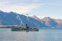 TSS Earnslaw on Lake Wakatipu with the dramatic Remarkables mountains in the background, Queenstown, South Island, New Zealand. TSS Earnslaw was first launched in 1912, but is now used as a tourist boat, taking people from Queenstown to Walter Peak High Country Farm.