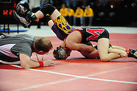 Marshall's Hunter Weber pins Ashland's Jack Pearce to win the Division 2, 119-pound weight class during WIAA state wrestling championships on Saturday, 2/26/11, at the Kohl Center in Madison, Wisconsin
