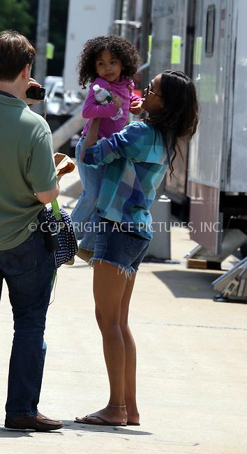 "WWW.ACEPIXS.COM . . . . .  ....June 14 2012, New York City....Actress Zoe Saldana on the set of the new movie ""Blood Ties' on June 14 2012 in New York City....Please byline: PHILIP VAUGHAN - ACE PICTURES.... *** ***..Ace Pictures, Inc:  ..Philip Vaughan (212) 243-8787 or (646) 769 0430..e-mail: info@acepixs.com..web: http://www.acepixs.com"