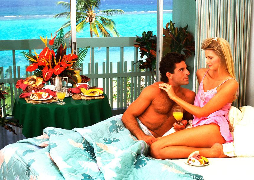 Honeymoon couple having breakfast in bed, Jamaica
