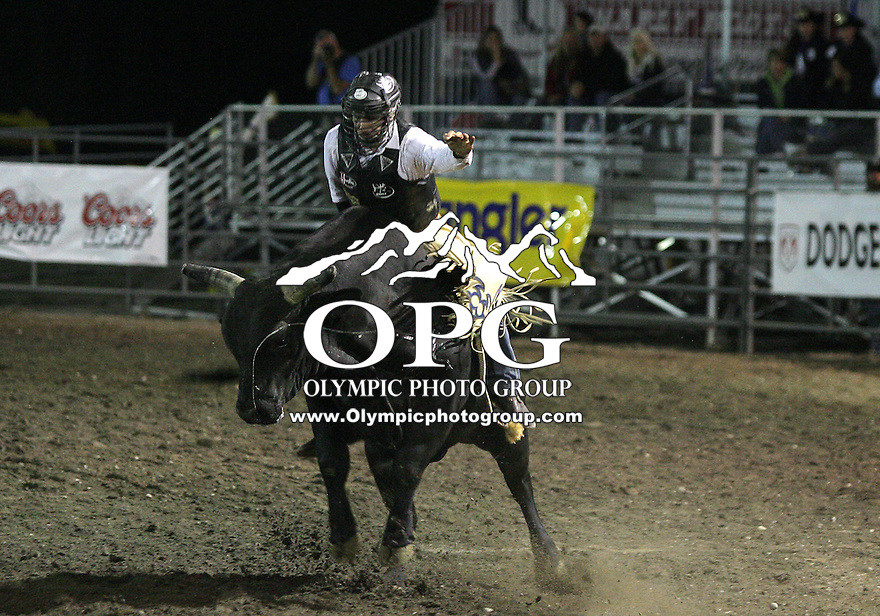 27 Aug 2010: Dustin Elliott scored a time 76 while riding the bull Bad Jackie in the Bull Riding competition at the Kitsap County Stampede Wrangle Million Dollar PRCA Silver Rodeo Tour Bremerton, Washington.