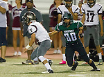 Torrance, CA 10/09/15 - Michael Cheng (South #80) and Tyler Maseuli (Torrance #5) in action during the Torrance vs South High varsity football game.  South defeated Torrance 24-21.