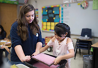 NWA Democrat-Gazette/CHARLIE KAIJO Lily Bounds, 13, helps Lexa Vorarath, 8, (from left) reform old paper into new paper during an art class, Monday, December 3, 2018 at Russell D. Jones in Rogers.<br />