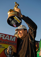 Sept. 19, 2010; Concord, NC, USA; NHRA funny car driver Cruz Pedregon celebrates after winning the O'Reilly Auto Parts NHRA Nationals at zMax Dragway. Mandatory Credit: Mark J. Rebilas-
