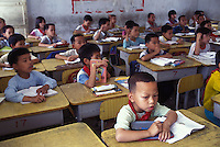 Young boys outnumber girls in a village school in Guangdong Province, South China. An average gender inbalance 118 males to 100 females caused by the Chinese Governments One Child Policy and the  preference for boys means that there is a shortage of women in China.