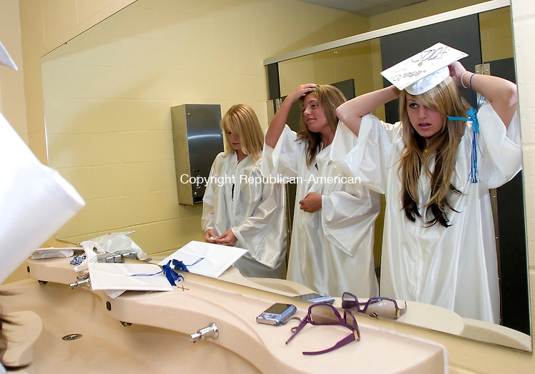 BURLINGTON, CT- 18 JUNE 2007- 061807JT06-<br /> From right, Lewis Mills graduates Ashley Penna, Gina D'Addario, and Jennilee Tracy get ready in the girls' bathroom before commencement ceremonies at the high school in Burlington on Monday.<br /> Josalee Thrift Republican-American