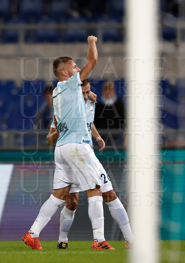 Calcio, Serie A: Roma, stadio Olimpico, 22 ottobre 2017.<br /> Lazio's Ciro Immobile (l) celebrates after scoring with his teammate Stefan Radu (r) during the Italian Serie A football match between Lazio and Cagliari at Rome's Olympic stadium, October 22, 2017.<br /> UPDATE IMAGES PRESS/Isabella Bonotto