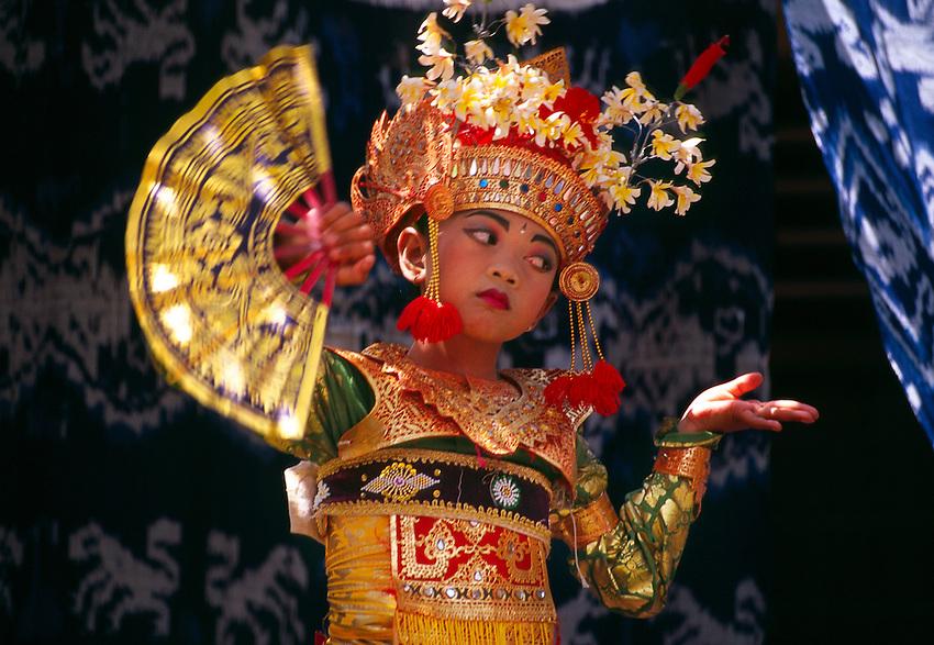 Young Balinese dancer performs legong, Peliatan, Bali, Indonesia