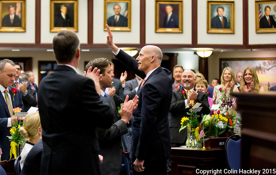TALLAHASSEE, FLA. 3/3/15-Gov. Rick Scott, center, is recognized during the opening day of the 2015 Legislative Session, Tuesday at the Capitol in Tallahassee.<br /> <br /> COLIN HACKLEY PHOTO