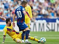 2nd November 2019; Estadi Ciutat de Valencia, Valencia, Spain; La Liga Football, Levante versus FC Barcelona; Enis Bardhi of Levante UD slide tackled by Lionel Messi of FCB  - Editorial Use