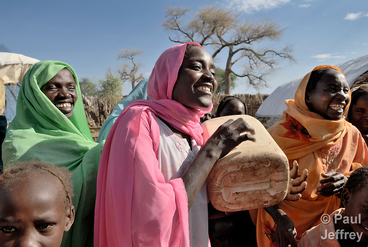 Women celebrate the everyday joys despite living in a camp for internally displaced people outside the village of Kubum, in Sudan's West Darfur state.