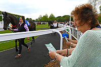 Horses being watched int the Parade Ring during Afternoon Racing at Salisbury Racecourse on 16th May 2019
