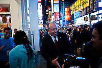 Microsoft Corp. Chief Operating Officer Kevin Turner ( C) welcomes customers during the opening of Microsoft's store at Times Square in New York, October 25, 2012. . Photo by Eduardo Munoz Alvarez / VIEW.