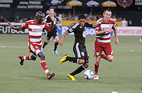 DC United midfielder Andy Najar (14) goes against FC Dallas midfielder Daniel Hernandez (2) right and Jair Benitez (5) left.   FC Dallas defeated DC United 3-1 at RFK Stadium, Saturday August 14, 2010.