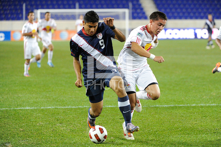 Mario Rodriguez (9) of the USA and Bryan Gallego (4) of the New York Red Bulls. The USMNT U-17 defeated New York Red Bulls U-18 4-1 during a friendly at Red Bull Arena in Harrison, NJ, on October 09, 2010.