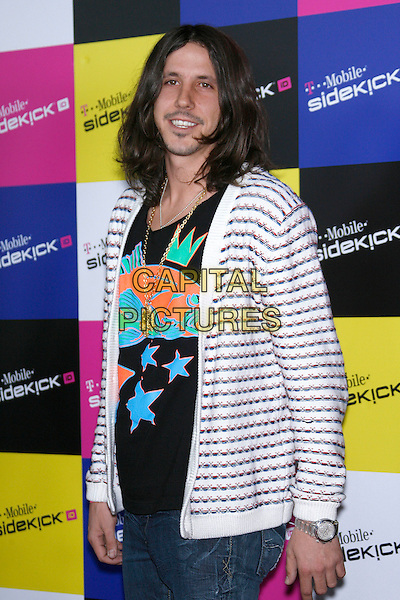CISCO ADLER of WHITESTARR.Attending the T-Mobile Sidekick iD Launch, .held at the T-Mobile Sidekick Lot,  Los Angeles, California, USA,13 April 2007..half length long hair stubble beard blue and white striped top.CAP/ADM/ZL.©Zach Lipp/AdMedia/Capital Pictures.