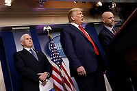 United States President Donald J. Trump, center, and US Vice President Mike Pence, left, listen to Stephen Hahn, Commissioner, US Food and Drug Administration (FDA) speaking during a press briefing on the Coronavirus COVID-19 pandemic with members of the Coronavirus Task Force at the White House in Washington on March 19, 2020. <br /> Credit: Yuri Gripas / Pool via CNP/AdMedia