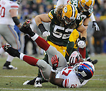 Green Bay Packers linebacker Clay Matthews, top, hovers over New York Giants running back Brandon Jacobs after making a tackle during the first quarter of the game at Lambeau Field in Green Bay, Wis., on Dec. 26, 2010.