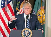 United States President Donald J. Trump makes remarks prior to signing three Executive Orders concerning financial services at the Department of the Treasury in Washington, DC on April 21, 2017.<br /> Credit: Ron Sachs / Pool via CNP