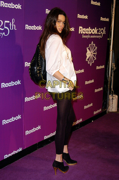"LARISSA BOND.At the Reebok 25th anniversary celebration of ""The Freestyle"" at Culture Club, New York, New York, USA,.21 February 2007..full length white top black leggings ankle boots bag.CAP/ADM/BL.©Bill Lyons/AdMedia/Capital Pictures. *** Local Caption ***"
