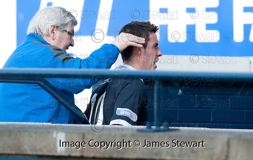 BRIAN GRAHAM HAS WORDS WITH SOMEONE IN THE STAND AFTER BEING SENT OFF