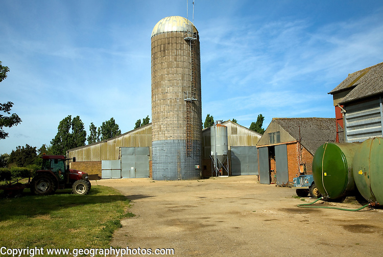 Tower silos grass storage silo in farm yard, Wickham Market, Suffolk, England