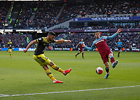 29th February 2020; London Stadium, London, England; English Premier League Football, West Ham United versus Southampton; Shane Long of Southampton crossing the ball into the box past Aaron Cresswell of West Ham United