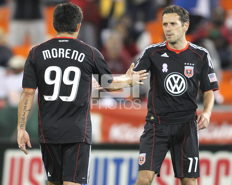 Jaime Moreno #99 of D.C. United passes Carlos Verela #11 after he leaves the field for the last time during an MLS match against Toronto FC that was the final appearance of D.C. United's Jaime Moreno at RFK Stadium, in Washington D.C. on October 23, 2010. Toronto won 3-2.