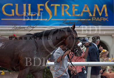 "Leaving winner's circle after winning Fountain of Youth ... ""Gulfstream Park"" sign in background"