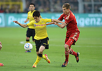 FUSSBALL   1. BUNDESLIGA   SAISON 2011/2012   30. SPIELTAG Borussia Dortmund - FC Bayern Muenchen            11.04.2012 Shinji Kagawa (li, Borussia Dortmund) gegen Holger Badstuber (re, FC Bayern Muenchen)