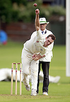 Freddie Barrass bowls for Highgate during the ECB Middlesex Division Three game between Highgate and Harrow Town at Park Road, Crouch End on Saturday May 24, 2014