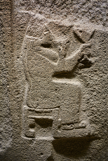 Alaca Hoyuk Sphinx Gate Hittite monumental relief sculpted orthostat stone panel. Andesite, Alaca, Corum, 1399 - 1301 B.C. Goddess. Anatolian Civilizations Museum, Ankara, Turkey.<br /> <br /> Sitting in a chair without a backrest, the head and the face of the figure are completely destroyed. She has a long veil on her head, a long dress hanging down to her ankles, and the shoes with the curved ends. The stool under her feet indicates that she is an important person. She drinks something from the vessel in her right hand and she keeps the handled goblet in her hand a little higher.
