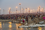 Pilgrims arriving to take a holy bath in the Ganges River in Allahabad for Kumbh Mela Festival
