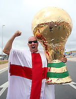 An England fan with a huge World Cup trophy outside Arena Corinthians