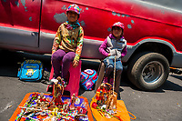 Mexican girls, sister-sister siblings, sit in front of Santa Muerte (Holy Death) altars during a religious pilgrimage in Tepito, a rough district of Mexico City, Mexico, 1 April 2018. The religious cult of Santa Muerte is a fusion of Aztec death worship rituals and Catholic beliefs. Born in lower-class neighborhoods of Mexico City, it has always been closely associated with crime. In the past decades, original Santa Muerte followers, such as prostitutes, pickpockets and street drug traffickers, have merged with thousands of ordinary Mexican Catholics. The Holy Death veneration, offering a spiritual way out of hardship in modern society, rapidly expanded. Although the Catholic Church still considers Santa Muerte followers the devil worshippers, on the first day of every month, crowds of Santa Muerte believers fill the streets of Tepito. Holding statues of Holy Death clothed in a long robe, they pray for healing, protection, money or any other favor in life.