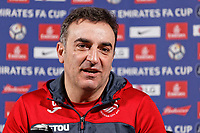 Manager Carlos Carvalhal speaks to members of the press at the Fairwood Training Ground near Swansea, Wales, UK