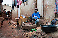 Felix Barugahare, 11,  in front of his home in Nsambya, neighbourhood in Kampala, Uganda on July 28 2011. Felix Barugahare plays 2nd base and is the youngest player for Rev. John Foundation Little League baseball team.
