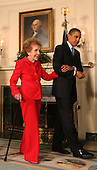 Washington, DC - June 2, 2009 -- United States President Barack Obama escorts former first lady Nancy Reagan to the signing of the Ronald Reagan Centennial Commission Act in the Diplomatic Reception Room of the White House on Tuesday, June 2, 2009.<br /> Credit: Dennis Brack / Pool via CNP