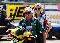 Sept. 25, 2011; Ennis, TX, USA: NHRA funny car driver John Force with daughter Courtney Force during the Fall Nationals at the Texas Motorplex. Mandatory Credit: Mark J. Rebilas-