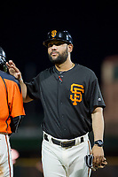 AZL Giants manager Hector Borg (13) pats Ismael Munguia (29) on the back during a game against the AZL Rangers on September 4, 2017 at Scottsdale Stadium in Scottsdale, Arizona. AZL Giants defeated the AZL Rangers 6-5 to advance to the Arizona League Championship Series. (Zachary Lucy/Four Seam Images)